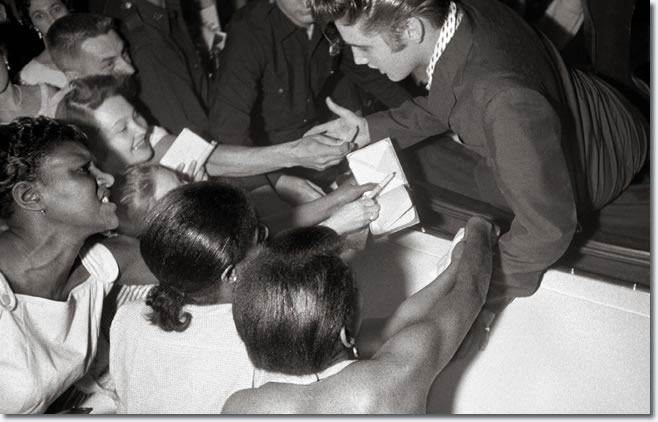 As Elvis left the Hudson Theater on July 1, 1956 his fans reached out for an autograph and to touch their idol.