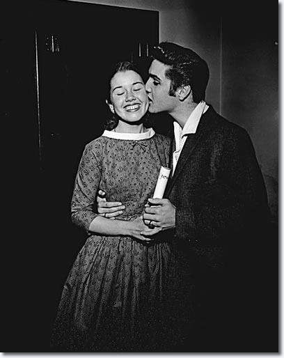 Elvis Presley kisses a fan at the Oakland Auditorium - June 3, 1956