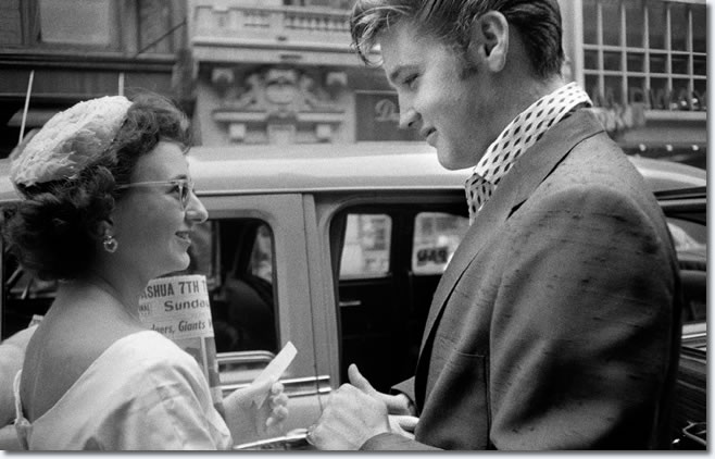 Elvis Presley - Arriving at the Hudson Theater in New York City to perform on the Steve Allen comedy show - July 1, 1956