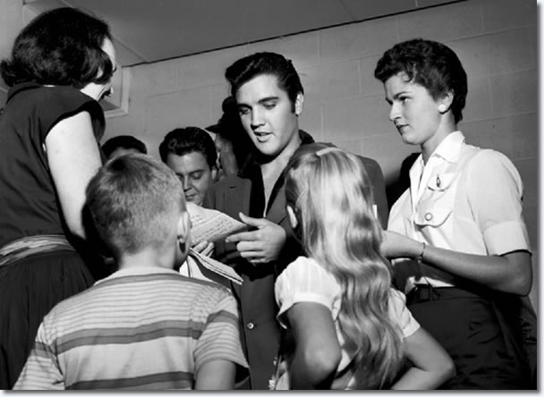 Golden-haired Gail McEwen (foreground), 10-year-old daughter of Mr. and Mrs. L.Q. McEwen of 3719 Deerwood Cove, was one of the youngsters on hand at WKNO in September 20, 1957 to get the famous Elvis Presley autograph.