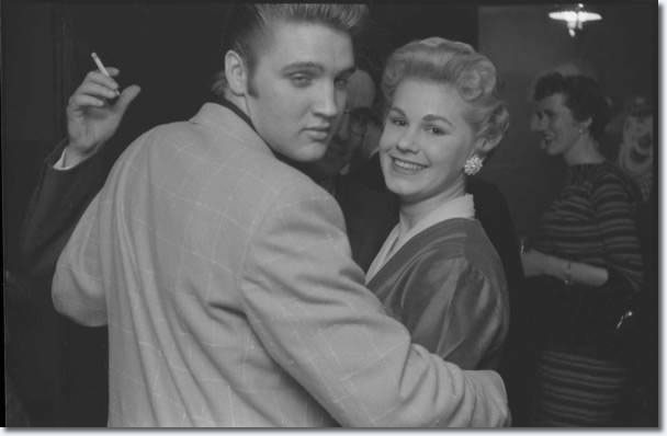 Elvis Presley relaxes at an adult party in Detroit after his Fox shows on May 25, 1956.