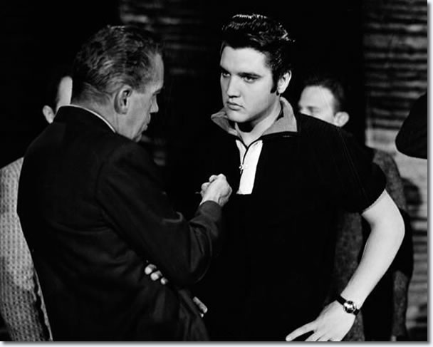 Ed Sullivan and Elvis Presley.