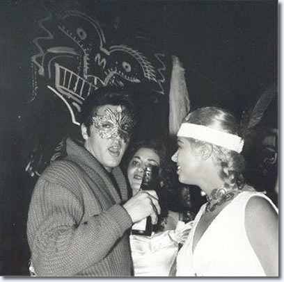 Elvis with actress Jeanne Carmen at Sy Devore's Halloween party: October 31st, 1957: Beverly Hills, California