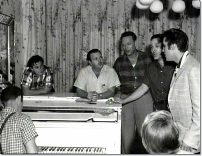 Elvis Presley with the Sunshine Boys, Lamar Fike and Anita Wood, Graceland in August 1957.