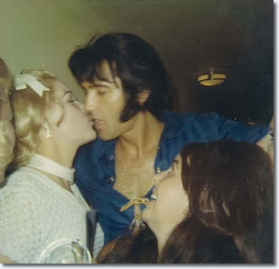 Elvis Australia club member, Mickie M. Malbrough being kissed by Elvis!