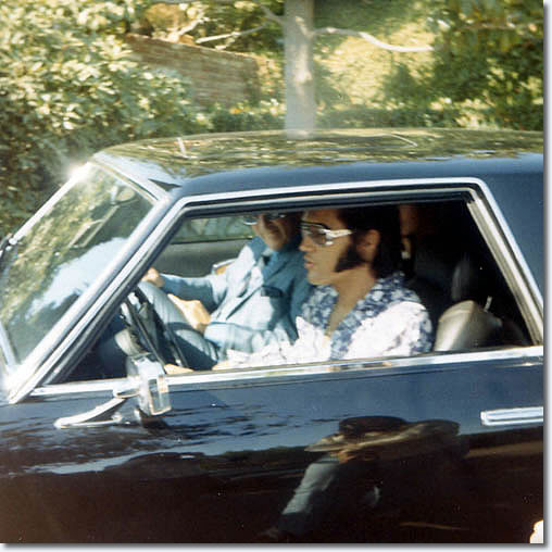 Elvis and John O' Grady leave Elvis' Hillcrest home in his Stutz Blackhawk : October 9, 1970.