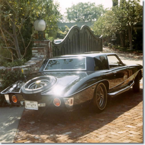 Elvis' Stutz Blackhawk passing the gates of his Hillcrest home : October 9, 1970.