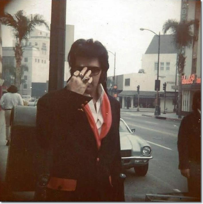 Elvis Presley. Possibly from in or around April of 1971 in Beverly Hills. Elvis had just visited the eye doctor.