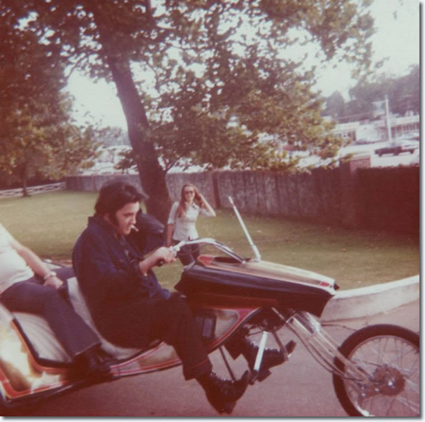 Only Elvis Presley could make this work, out for a ride wearing his pajamas.