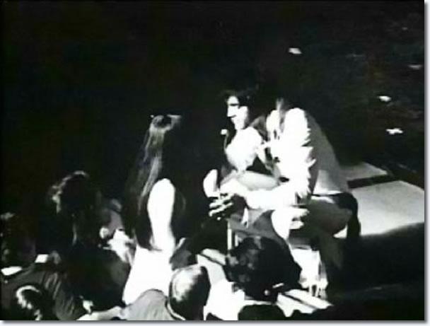 Priscilla talks with Elvis, stange front, Las Vegas concert
