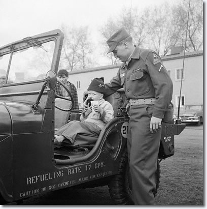 Elvis Presley - Ray Barracks Friedberg - Open House - Elvis with son of Ira Jones - April 11, 1959