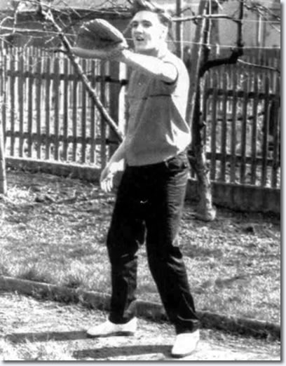 Elvis Presley in Germany, at home, playing baseball