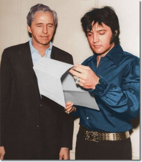 Elvis and Hilton Manager Alex Shoofey going thru a contract.