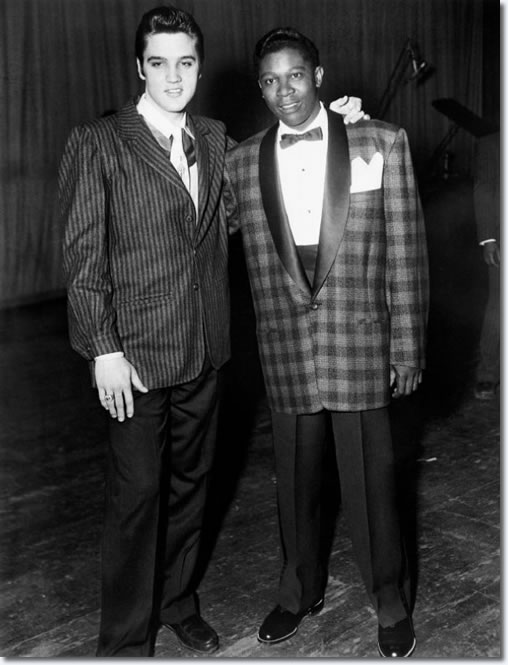 Elvis Presley and B.B. King backstage at the December 7, 1956 WDIA (Radio Station) Goodwill Revue at Ellis Auditorium. Although Elvis' recording contract did not permit him to perform at the fund-raiser for radio station WDIA, he set off a sensation. Elvis attends with George Klein. Photo by Ernest Withers.
