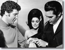 Elvis admiring Tom Jones' watch