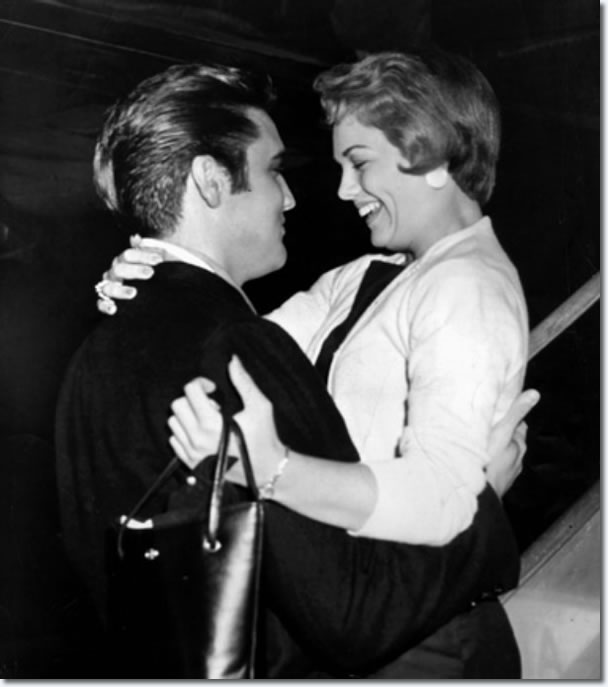 Elvis Presley and Anita Wood embrace as she steps from an airliner at Memphis Municipal Airport the night of Sept. 13, 1957. Miss Wood, hostess for a Memphis TV show, 'Top 10 Dance Party', was returning from a week in Hollywood preparing for her first movie role in 'Girl in the Woods'.