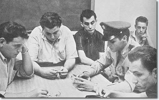 August the 13th 1958. Alan Fortas, Lamar Fike, George Klein, Elvis Presley, Billy Smith and Louis Harris, pictured sat round a table in the hospital conference room waiting for news of Elvis' mother's condition.