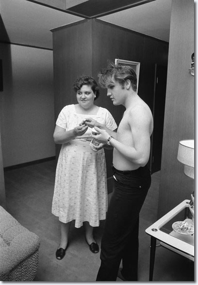 Elvis Presley with his mother, Gladys, at home in Memphis, Tennessee, on July 4, 1956
