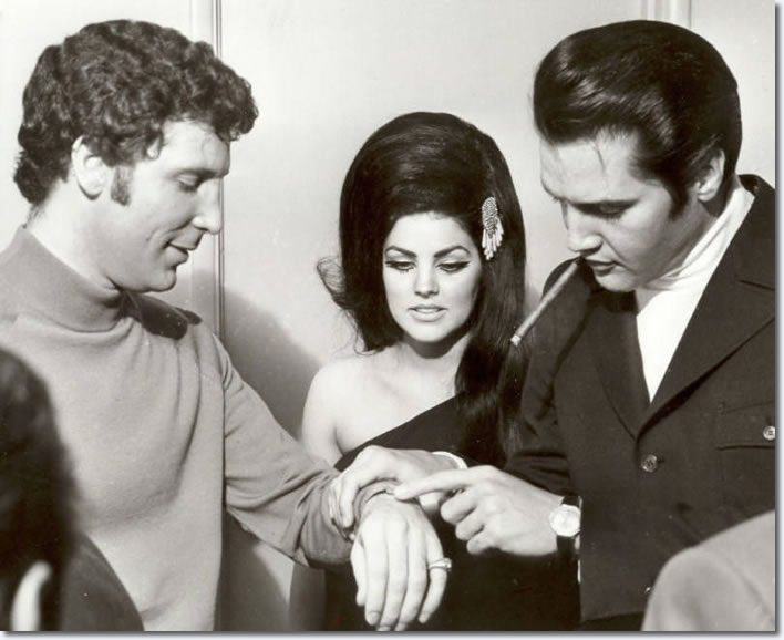 Elvis Presley admiring Tom Jones' watch