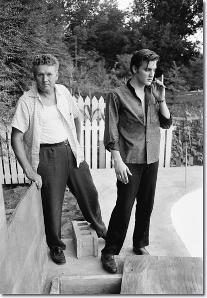 Elvis Presley with his father, Vernon, at home in Memphis on July 4, 1956