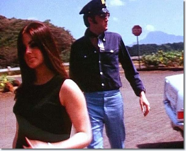 Priscilla and Elvis Presley on holiday, Hawaii - Notice Elvis wearing a police cap