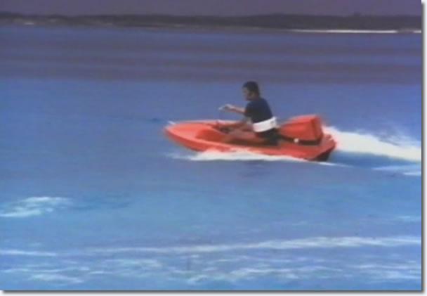 Elvis Presley in a mini speedboat, on holiday, Hawaii