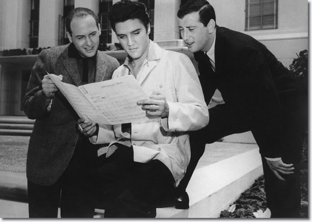 A publicity photograph with Mike Stoller, Elvis holding some sheet music for 'Jailhouse Rock' and Jerry Leiber