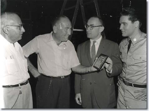Director Norman Taurog, Producer Hal Wallis, unknown with award and Elvis.