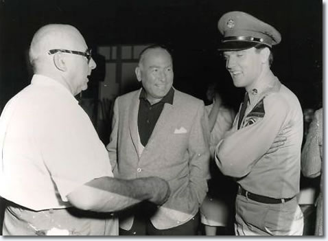 Director Norman Taurog, Producer Hal Wallis and Elvis Presley.