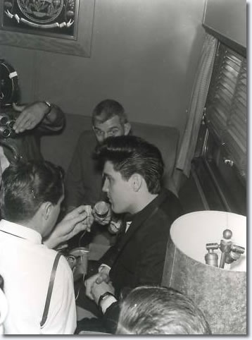 On board the train, Elvis talks to the press, LA April 20th 1960 en-route to start the filming of 'G.I. Blues'.