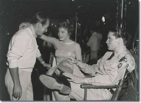 Choreographer Charles O'Curran and Juliet Prowse enjoy light hearted conversation as Elvis is lost in thought.