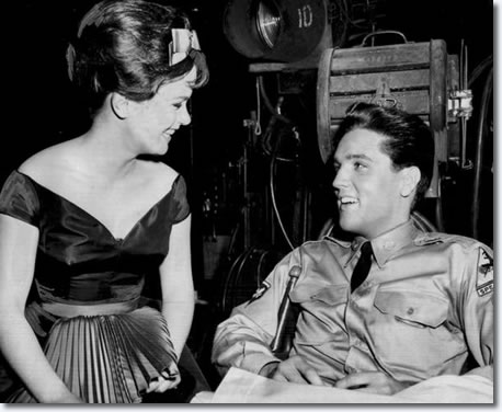 Elvis Presley chats with leading lady, Leticia Roman, 19, on the set of 'G.I. Blues' at Paramount Studio in Hollywood May 26, 1960. The film was Presley's first since his release from the Army, and the first ever for Miss Roman, an import from Italy. One Hollywood producer was already pegging her as another Lollobrigida.