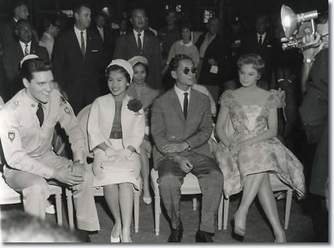 The King & Queen of Thailand visit the set with Juliet Prowse sat far right