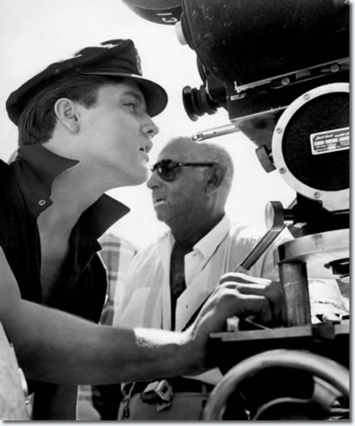 Elvis Presley looks at a camera angle on the set of the 1963 movie, 'Girls!, Girls!, Girls!'