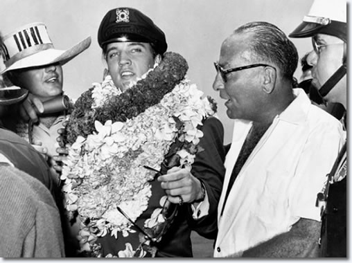 Elvis Presley and producer Hal Wallis (right center) being interviewed arriving at the island location for filming of the 1962 Paramount release of 'Girls! Girls! Girls!' (Paramount)