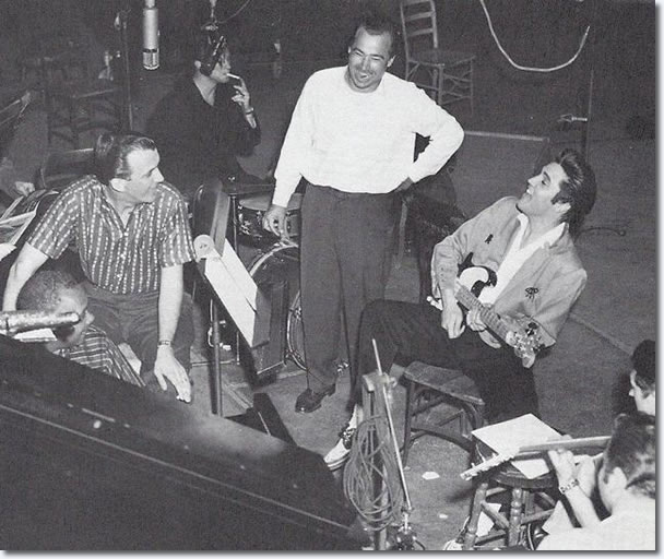Dudley Brooks at the piano, Hugh Jarrett, Bill Black, Elvis holding electric bass and Scotty Moore on guitar