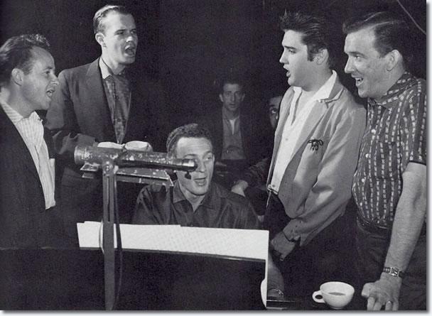 Gordon Stoker, Neil Matthews, Hoyt Hawkins at the piano, D.J. Fontana, George Klein, Elvis and Hugh Jarrett gather around for some warm up harmonies