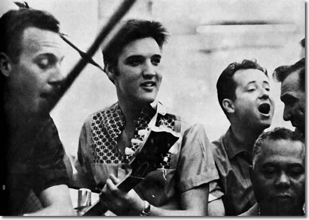 Hoyt Hawkins, Elvis with upturned guitar in hand, Gordon Soker, Hugh Jarrett and Dudley Brooks