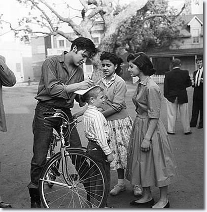 Elvis signs some autographs on the Paramount lot