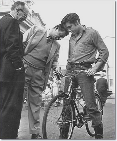 Loving You director, Hal Kanter, inspects Elvis' bike