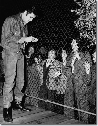 Elvis signing autographs on the set of Loving You