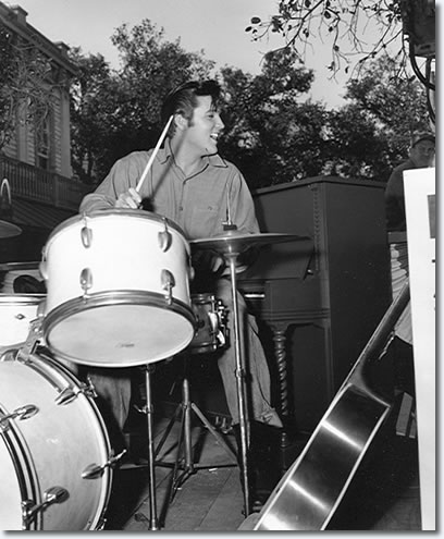 Elvis playing with D.J. Fontana's drums