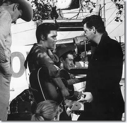 Elvis talking to director Hal Kanter with Scotty Moore in the background,for the opening 'Got A Lot O' Livin' To Do' production number.Dolores Hart is pictured in the foreground.