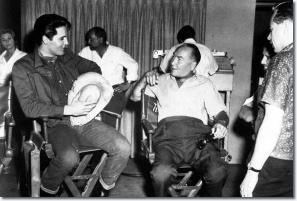 Elvis Presley and Hal Wallis on the set of 'Roustabout', 1964.