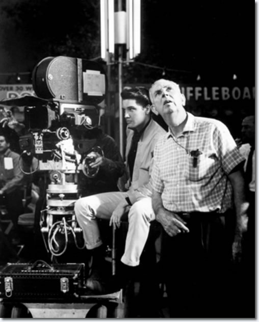 Elvis Presley during filming of Roustabout with Chet Stafford, chief gaffer on the film, who spots the lighting. Filmed in Technicolor and Technicscope, 'Roustabout' was a Hal Wallis production starring Presley and co-starring Barbara Stanwyck, Joan Freeman and Leif Erickson. John Rich directed.