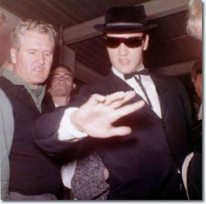 Elvis is pictured at Memphis Airport,with Vernon Presley and friend Gary Pepper in the background.