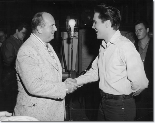 Elvis shakes hands with Colonel Parker, Friday January 6th 1961 - on set Birthday celebrations for Elvis 26th Birthday. Lamar Fike is on the left of frame and Sonny West on the right of frame.