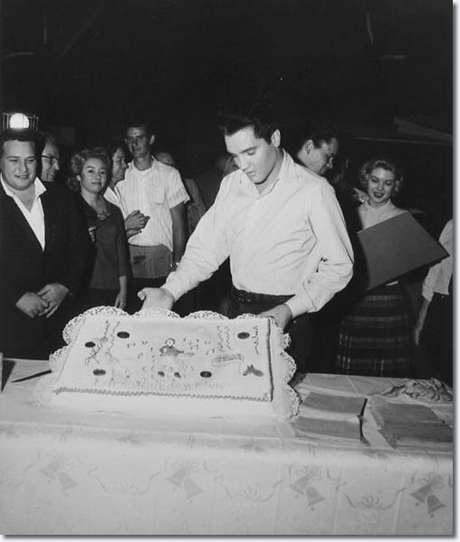 Elvis holds his birthday cake.