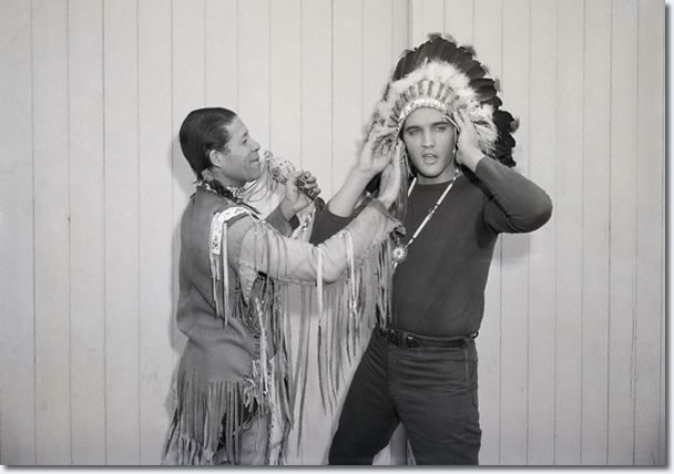 Elvis Presley is inducted into the Los Angeles Tribal Council by Chief Wha-Nee-Ota for his 'constructive portrayal of a man of Indian blood' in Flaming Star. Picture taken around 19th-23rd December 1960.