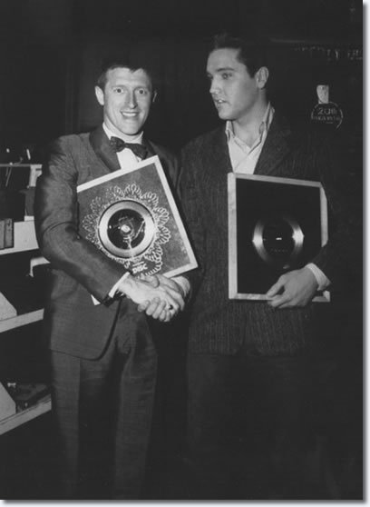 D.J. Jimmy Saville presents Elvis with a Gold Disc for 'It's Now Or Never'.